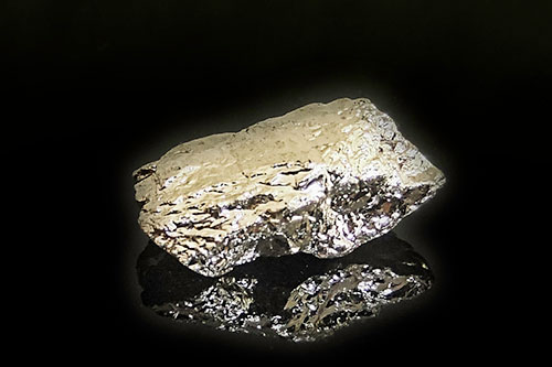 grain of sugar coated with 24K gold